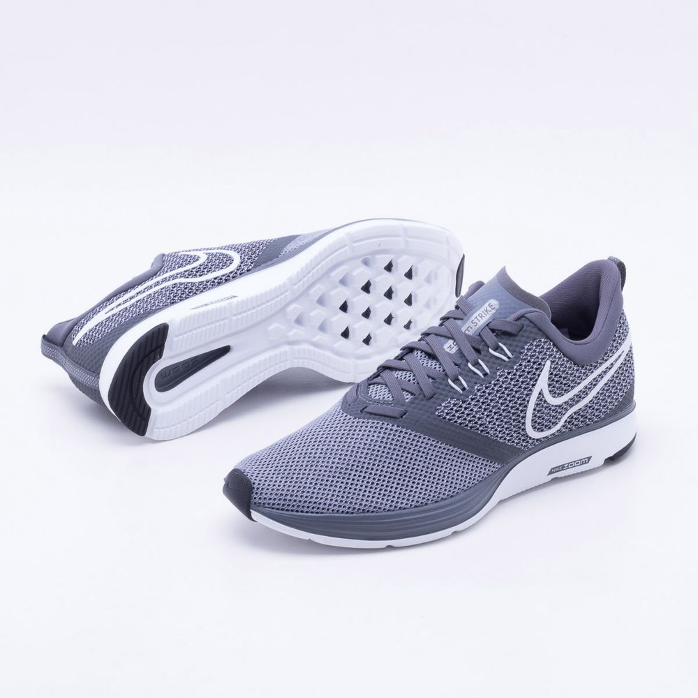 dd9a0aafca Tênis Nike Zoom Strike Masculino Cinza e Branco - Gaston - Paqueta Esportes