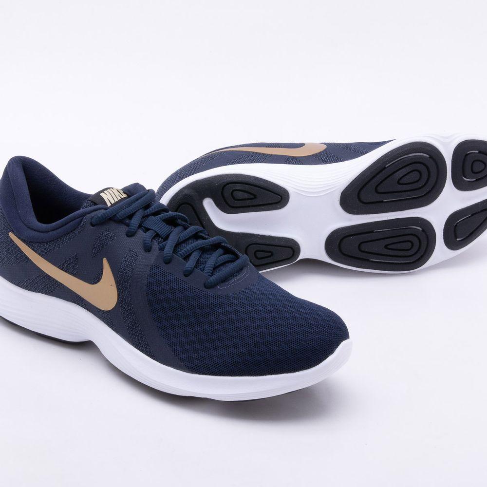 aa23e83fab9 Tênis Nike Revolution 4 Feminino Azul e Dourado - Gaston - Paqueta ...